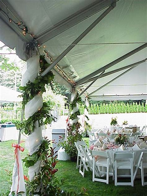 Outdoor wedding tent pole decorations.   Wedding Ideas