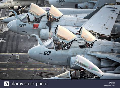 Ea Background Check Us Navy Maintenance Crews Run Checks On Ea 6b Prowler Aircraft On The Stock Photo