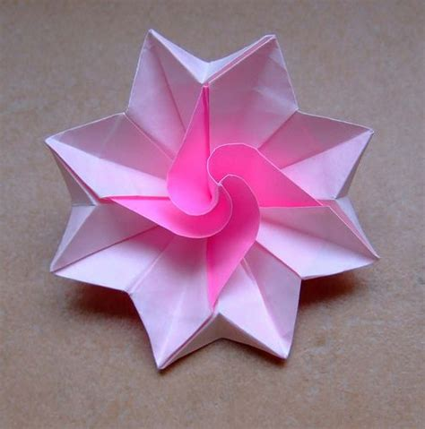 Designer Origami Create 40 Stunning And Practical Origami origami flower by evi binzinger no diagrams this artist makes such wonderful designs i wish