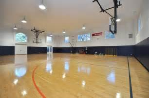 Marvelous indoor basketball court with bright lighting coming from