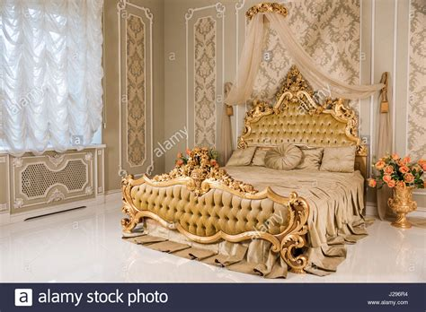 Luxury bedroom in light colors with golden furniture details. Big Stock Photo: 139115176 Alamy
