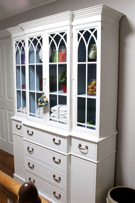 paint updates a linen cabinet that was once a china cabinet