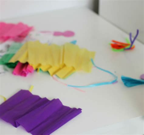 How To Make Butterflies Out Of Tissue Paper - tissue paper butterfly craft in the playroom