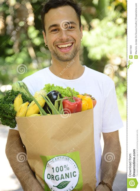carrying bag of food happy carrying a bag of organic food stock image image 38377061