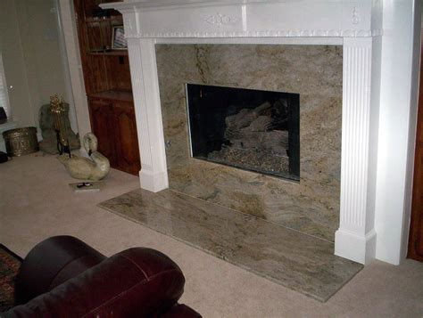 living room with gray marble fireplace surround and light
