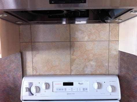 cheap kitchen backsplash panels made a cheap and easy backsplash using simple vinyl floor tiles diy easy