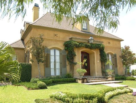 a new house inspired by old french country cottages old metairie country french traditional landscape