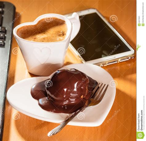 Links From Chocolate Keyboards To Espresso by Cup Of Coffee And Chocolate Cake Next To Computer Stock