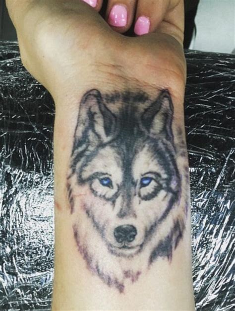 wolf wrist tattoo designs ideas and meaning tattoos for you