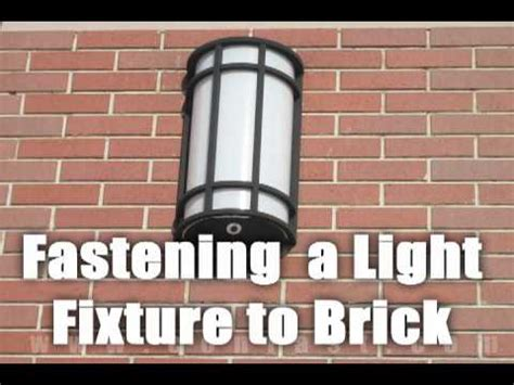 Fastening A Light To A Brick Wall With Sleeve Anchors How To Attach Lights To Brick
