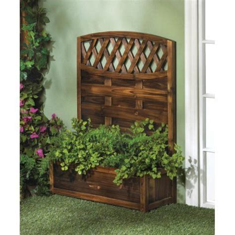 gorgeous wooden trellis planter box up the side of