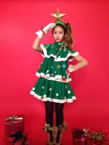 Crayon pop dress up as christmas trees for their upcoming carol