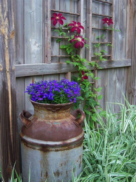 Milk Jug Planter by Antique Milk Jug As Flower Container Garden Ideas