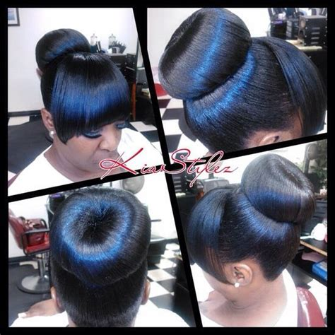donut bun hairstyle with bangs high donut bun w bang hair hairstyles pinterest