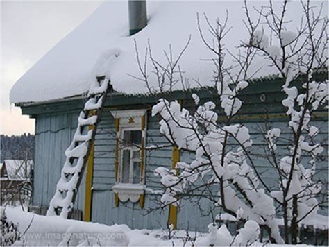 wooden russian house in winter covered with snow stock winter christmas photo gallery 2 images of nature
