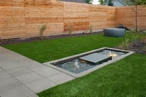Horizontal cedar fence landscape modern with artificial grass