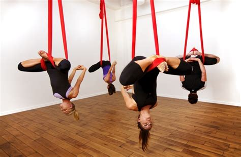 yoga swing exercises lifting off at an aerial yoga class
