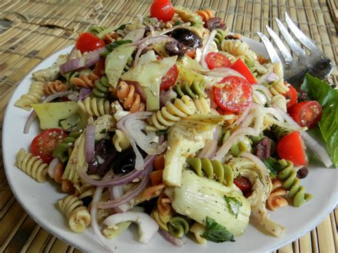 cold salad cold rotini pasta salad with tomatoes and artichoke hearts