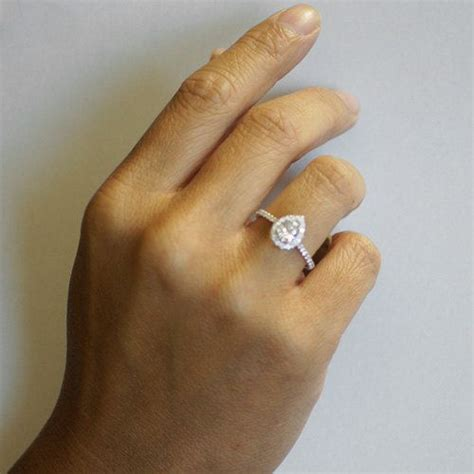pear shape teardrop halo engagement solitaire ring
