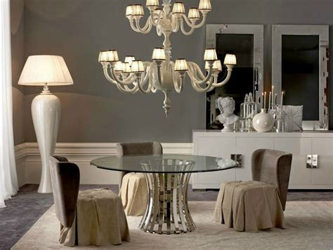 chandelier over table empire round glass dining table and chandelier over
