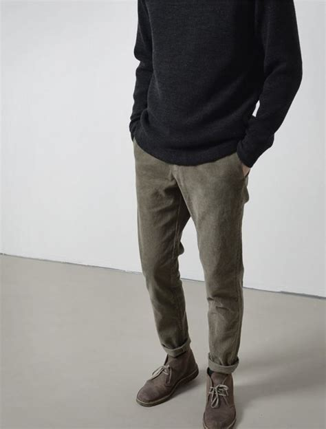 picture of olive grey trousers a black sweater and brown