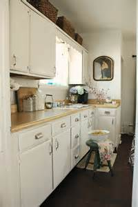 Behr swiss coffee white painted kitchen cabinets