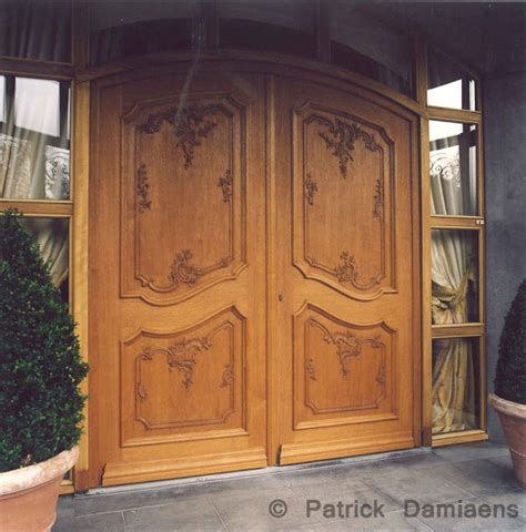 damiaens carved entry doors custom made