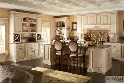 kraftmaid kitchen island kraftmaid maple cabinetry in biscotti with cocoa glaze