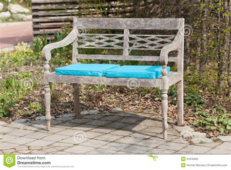 park bench seat park bench with blue seat cushions royalty free stock photo image 31978465