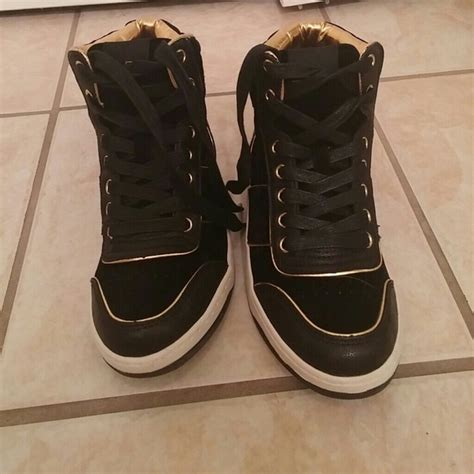 aldo aldo black and gold high top sneakers from