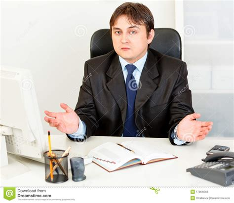 Man Sitting At A Desk Confused Modern Business Man Sitting At Desk Royalty Free