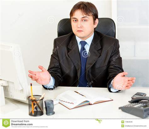 mens office desk confused business man sitting at office desk stock image