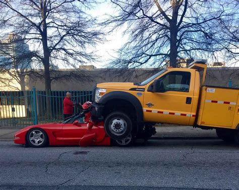 truck crashes ford truck crashes into chevrolet corvette driver survives