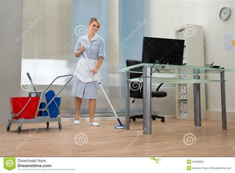 with mop in office stock photo image 55358652