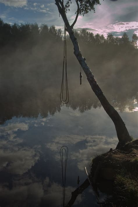 russian rope swing slideshow 599 08 rope swing for diving to a lake in
