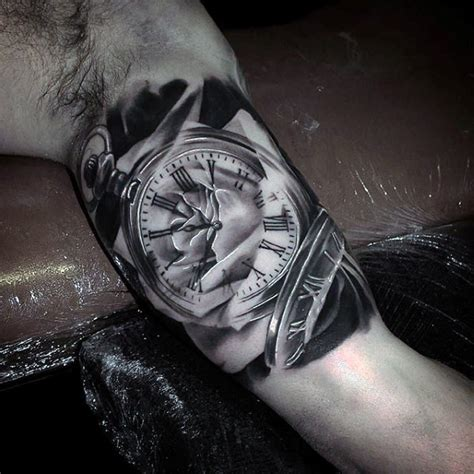 awesome natural looking black and white old clock tattoo