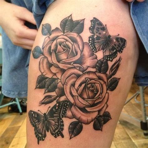 butterfly thigh tattoos big roses with grey butterfly on thigh
