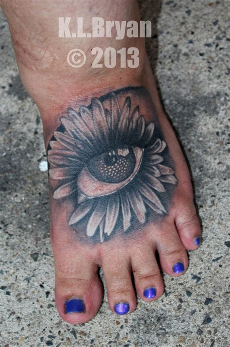 eye flower foot tattoo for girls