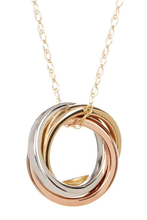candela 10k tricolor gold rolling rings charm necklace