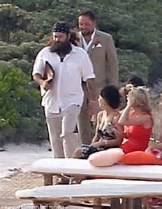 Groom attire jason looked beachy cool in a sandy coloured suit and