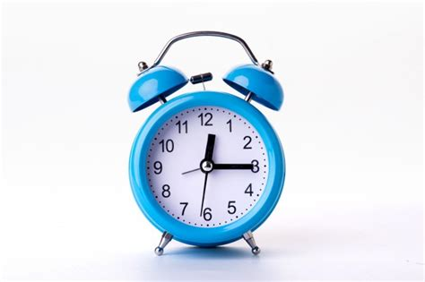 blue alarm clock on white background photo free
