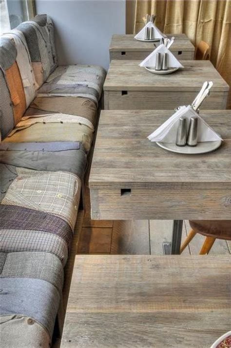 cafe bench seating repurposed restaurant pallet tables and bench seating upholstered with vintage men s
