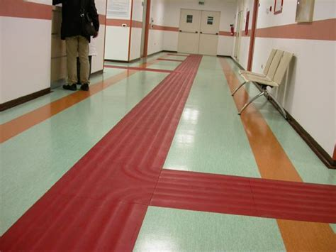 floor ls for visually impaired the red what looks like tape trail makes it easier for