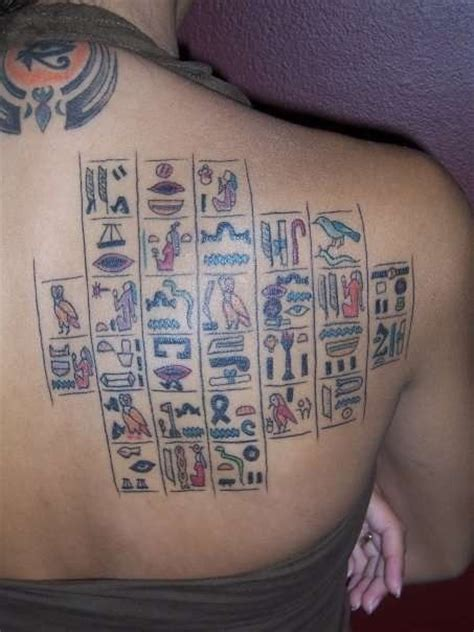 coloured egyptian hieroglyphs tattoo on back