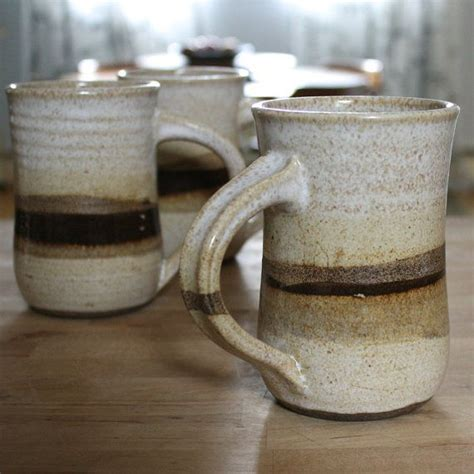 white speckled coffee mug with earthy stripe