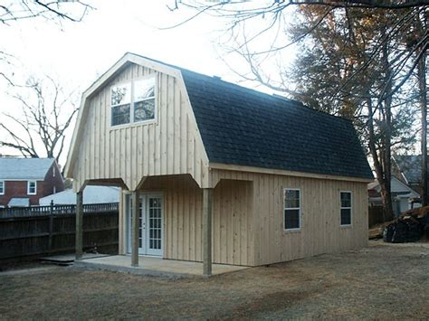 stick homes plans pole barn style roof  custom barn  gambrel roof   porch