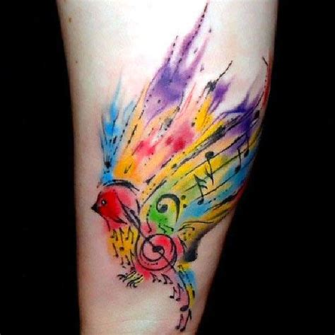 colorful watercolor songbird tattoo idea