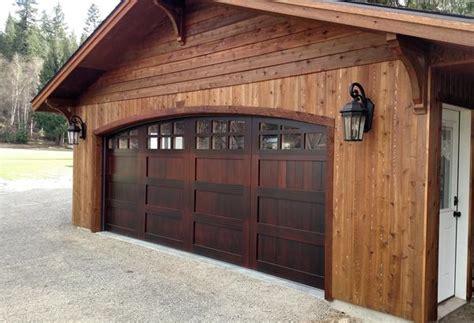 montage spanish style custom wood garage door lux