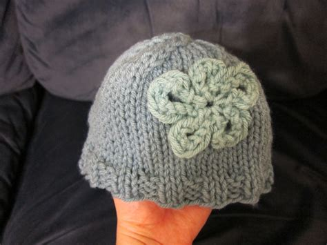 knit flower pattern for baby hat knitted baby hat with flower learning to be frugal