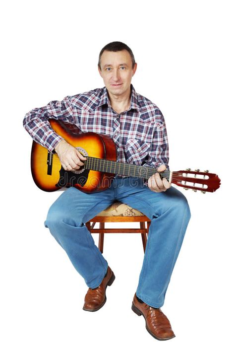 who is the guy that plays guitar and sings on the new direct tv commercials man plays a guitar sitting on an chair stock photo image